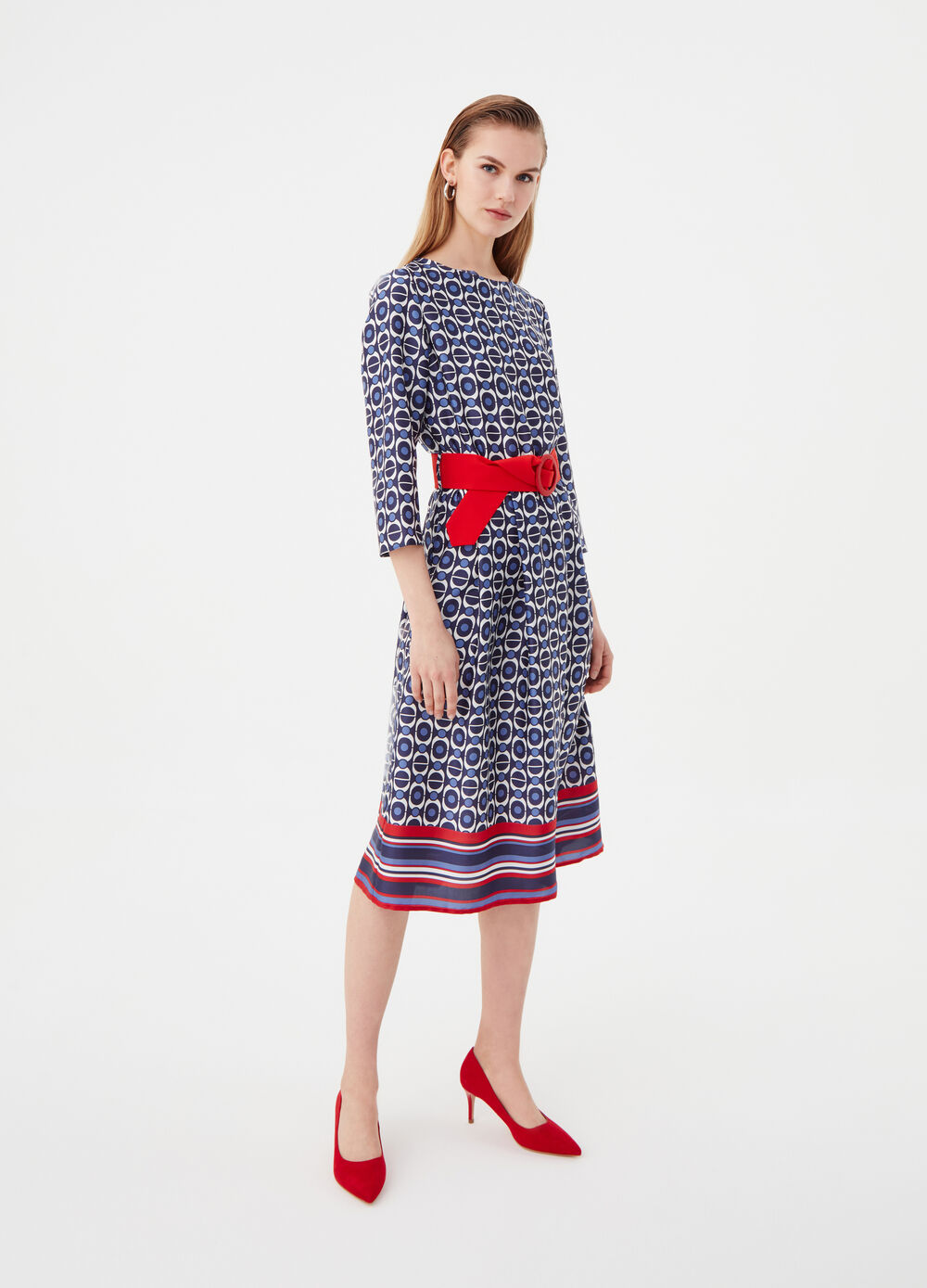 Dress with belt and geometric pattern