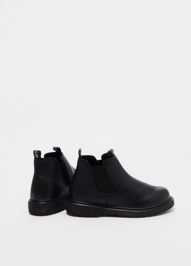 Leather-effect ankle boots with elastics on the sides image number null