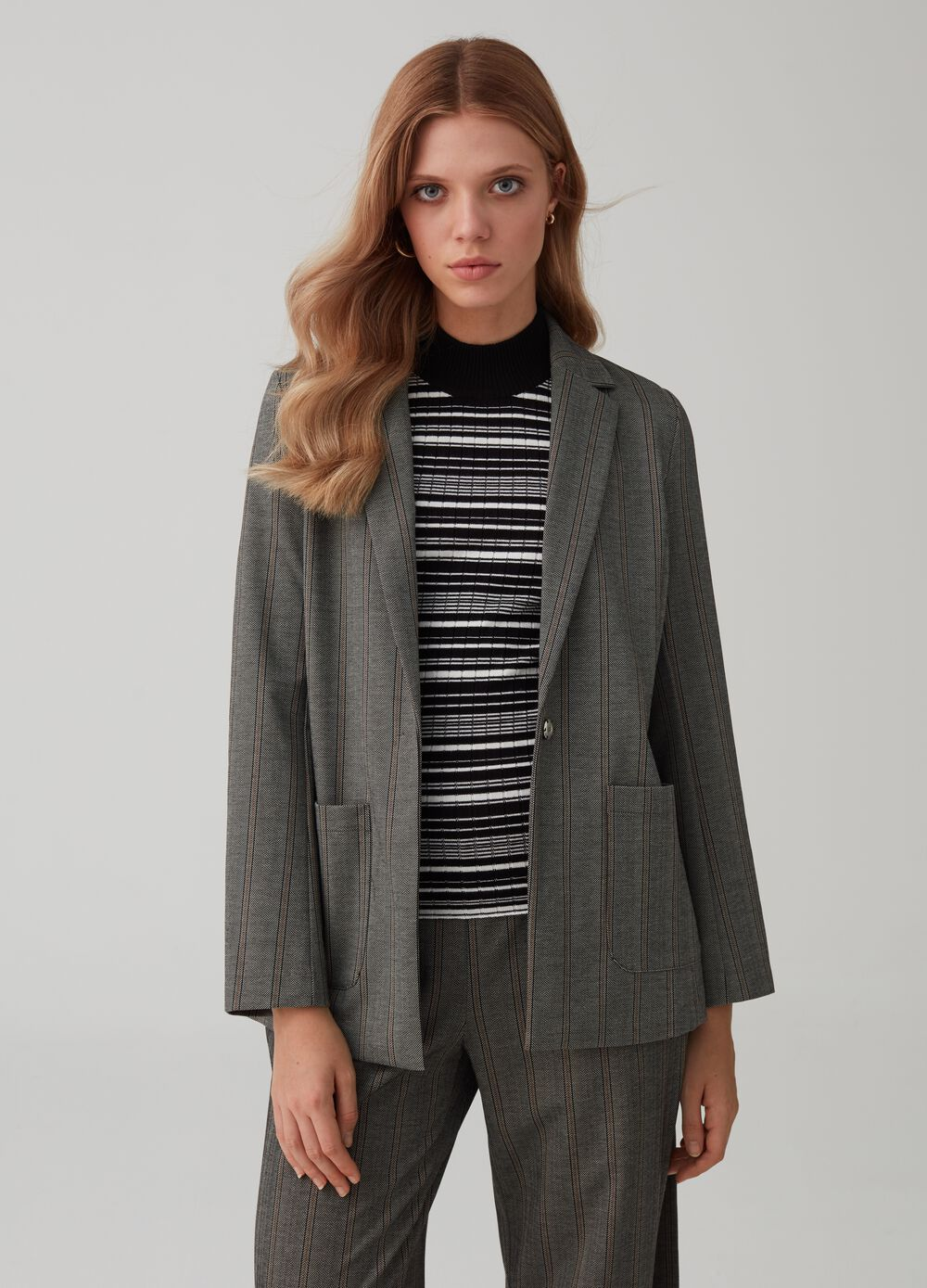 Blazer with belt and striped pockets