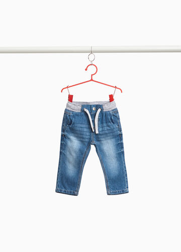Worn-effect jeans with whiskering and drawstring