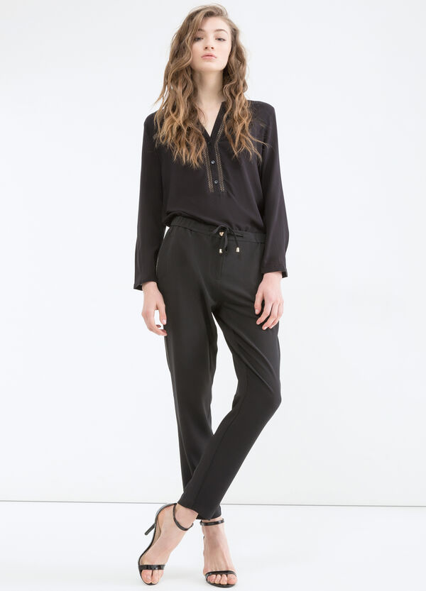 Stretch trousers with inserts   OVS