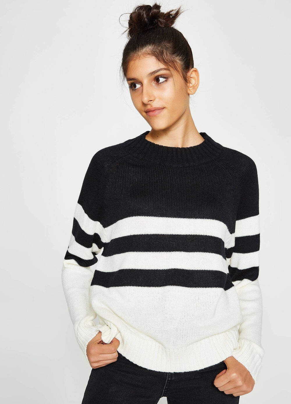 Knitted pullover with striped neckline
