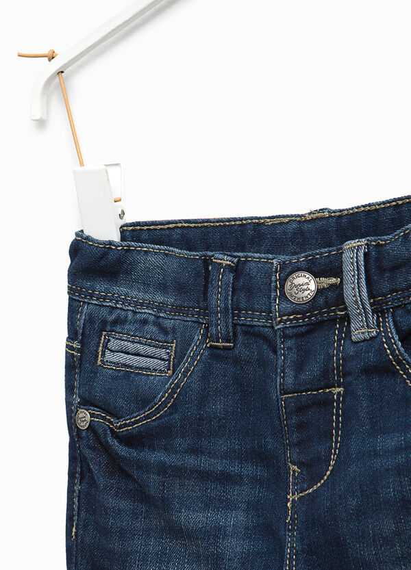 Worn-effect jeans with ribbing and abrasions | OVS