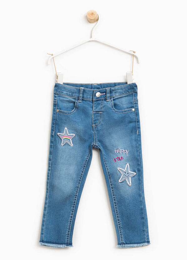 Faded stretch jeans with patches | OVS