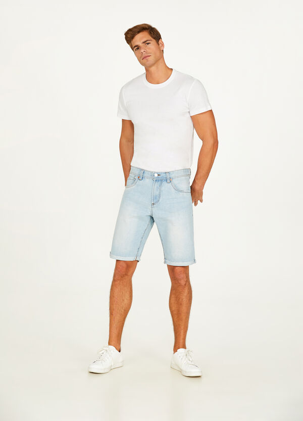 Washed denim Bermuda shorts with turn ups