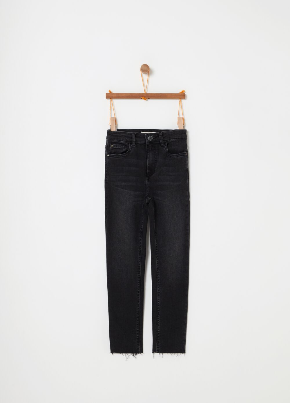 Stretch jeans with fading and fringed hem