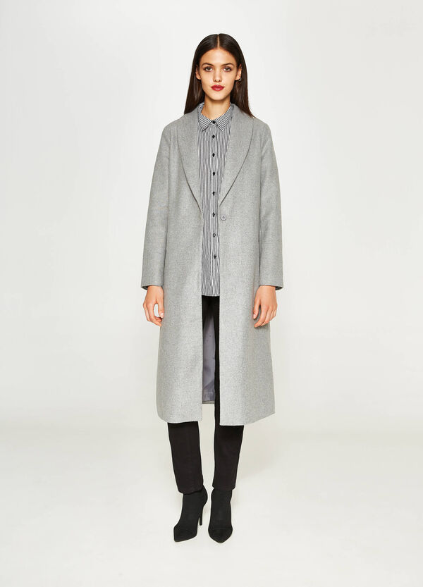 Long mélange coat with single button fastening.