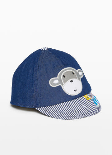 Baseball cap with monkey patch
