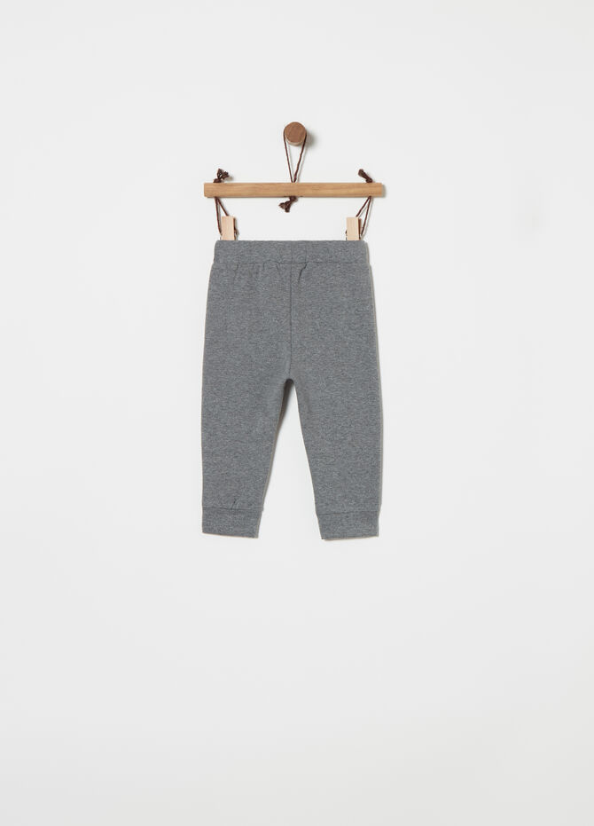 Stretch cotton trousers with print and pocket