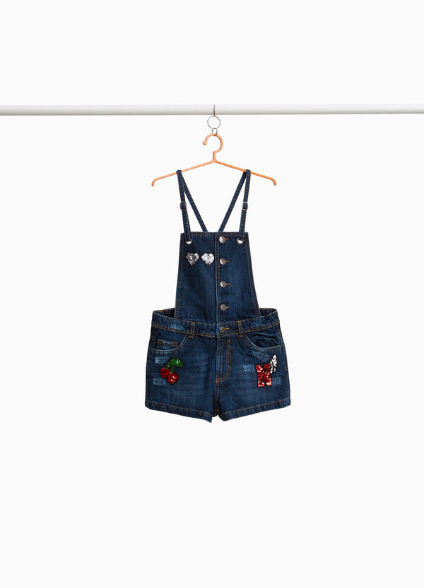 Worn-effect denim dungarees with sequins