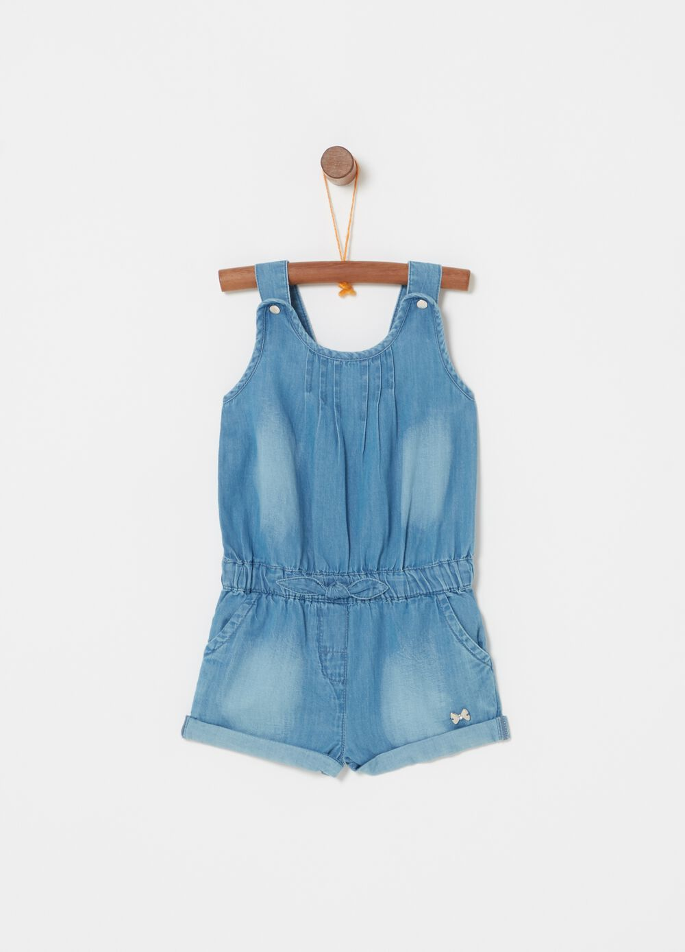 Light denim dungarees with tag