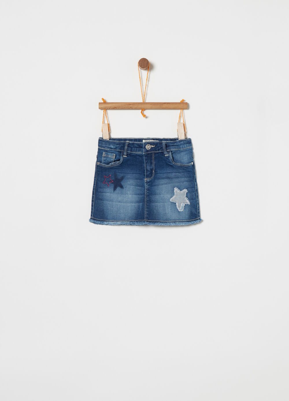 Denim skirt with embroidery and applications