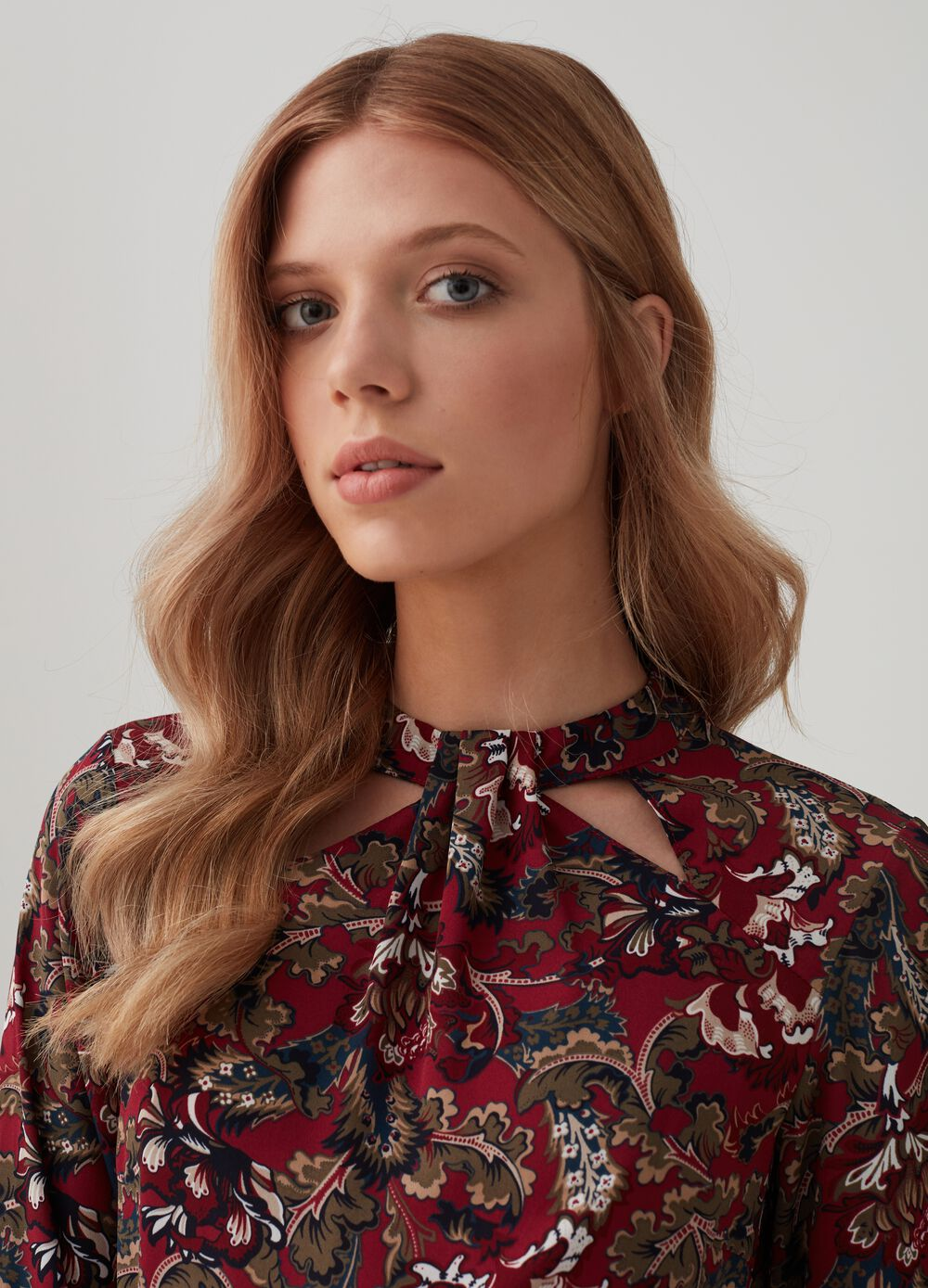 Long-sleeved blouse with floral pattern