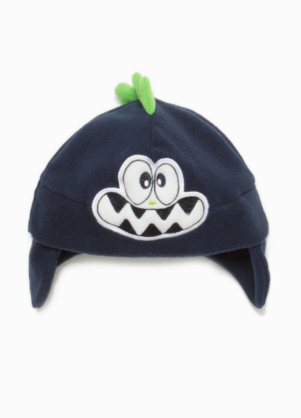 Beanie cap with crest and patch