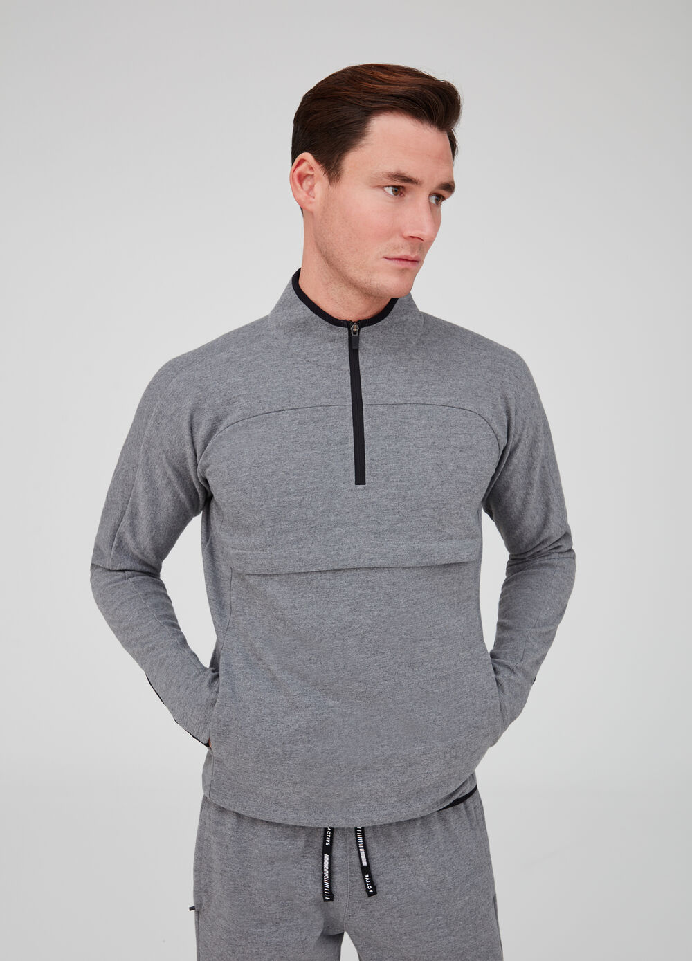 Gym sweatshirt with high neck, raglan sleeves and pockets