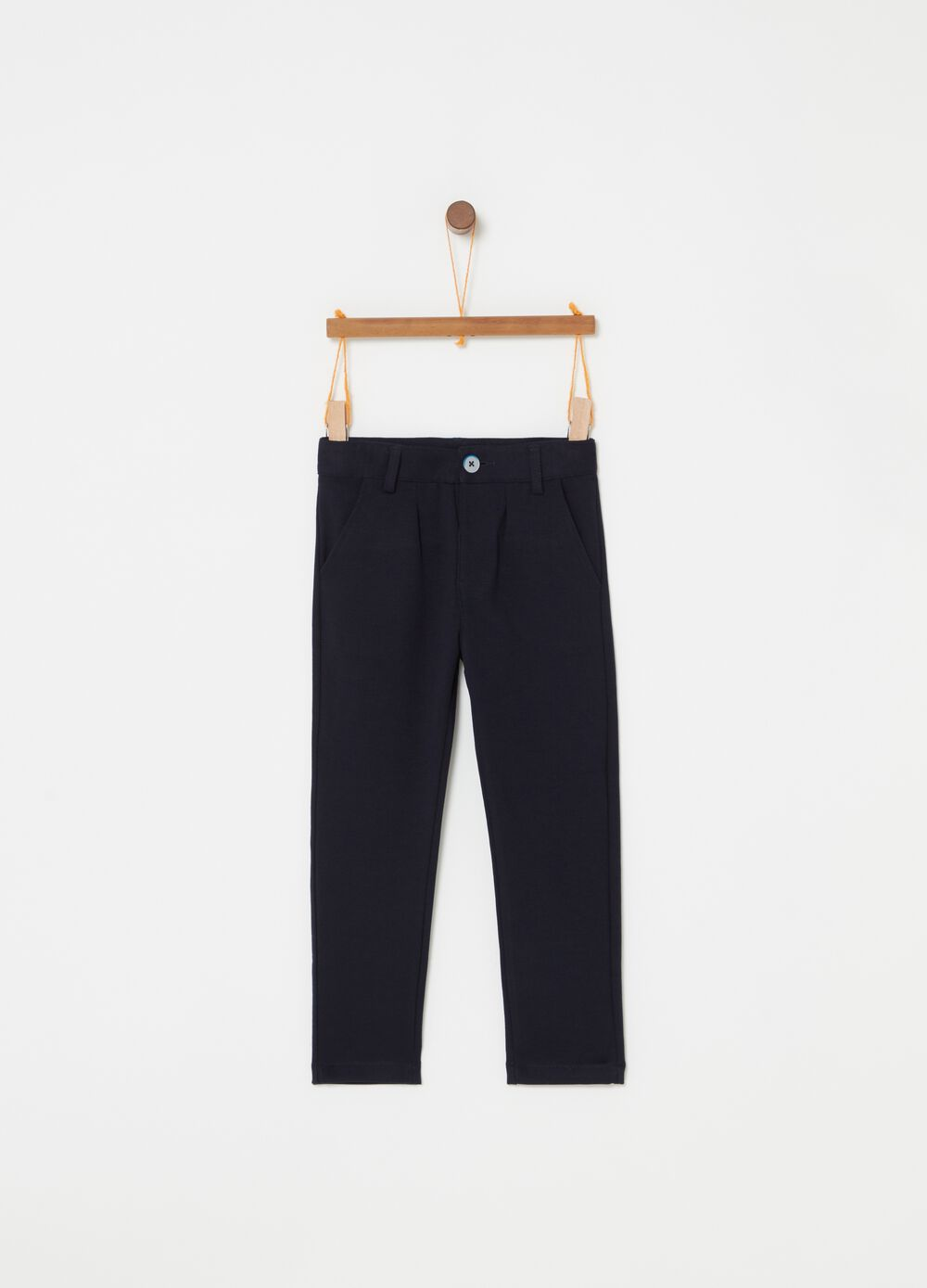 Stretch trousers with pockets and button