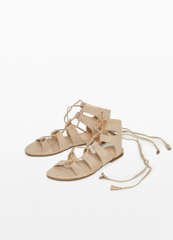 Sandals with fabric straps and laces
