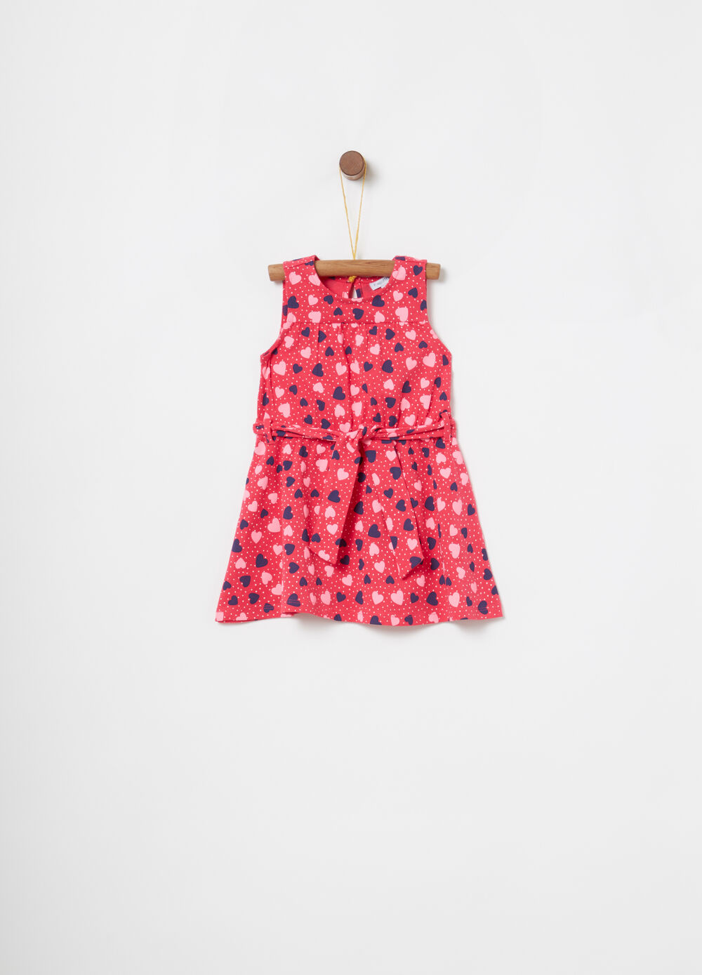Dress with sash and polka dot and heart pattern