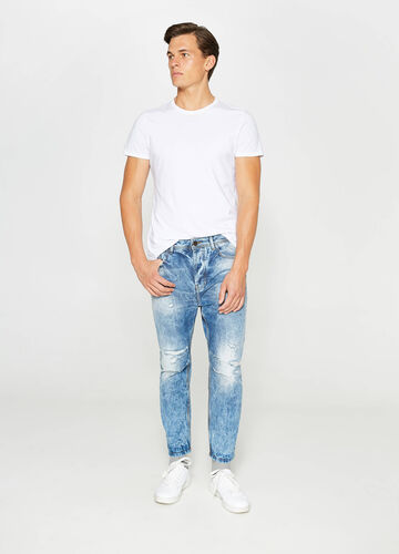 Mis-dyed, loose-fit jeans with rips