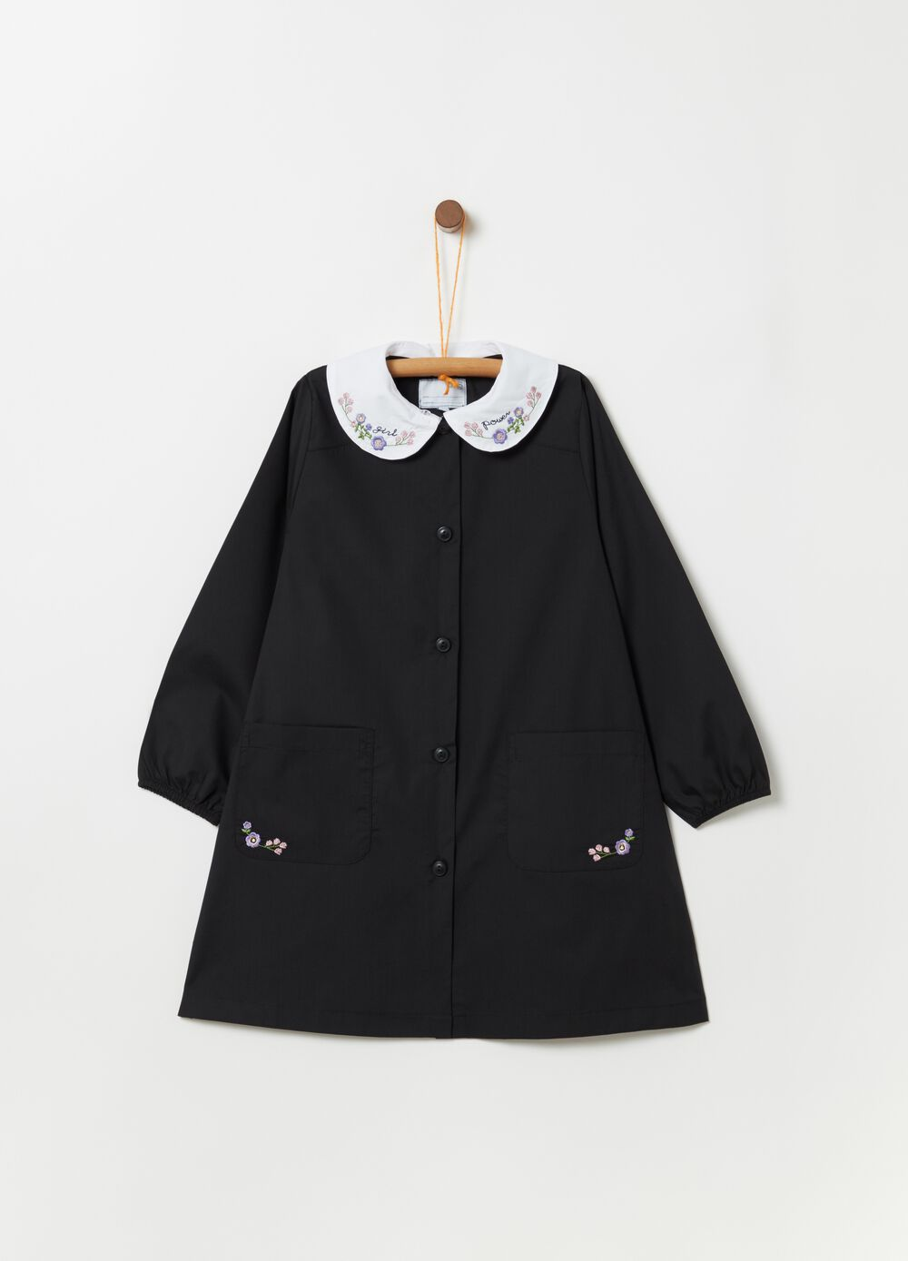 School smock with pockets and floral embroidery