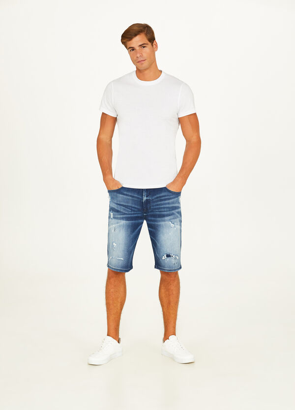 Stretch worn-effect denim Bermuda shorts with rips