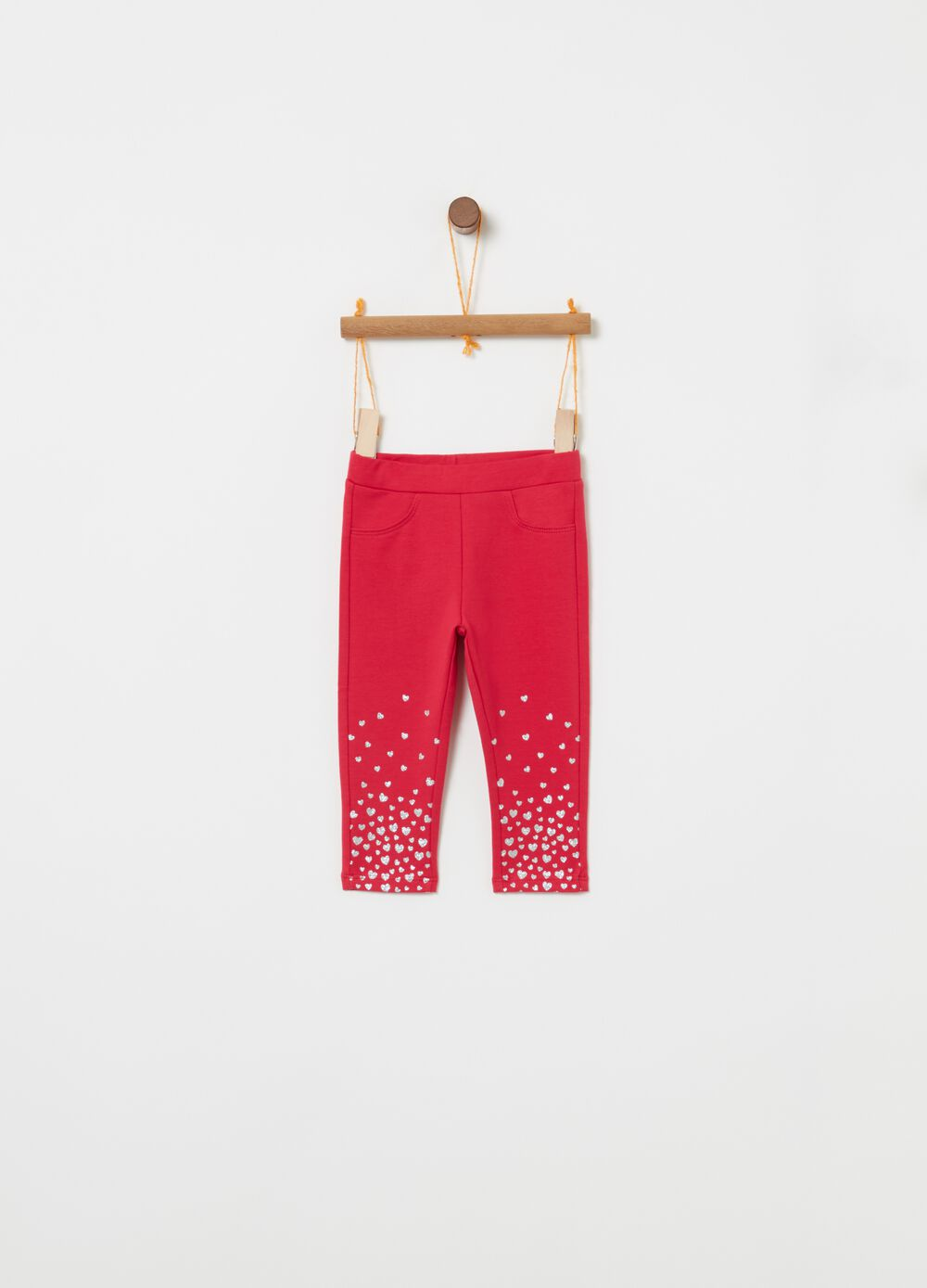 Trousers with elasticated waist and hearts print