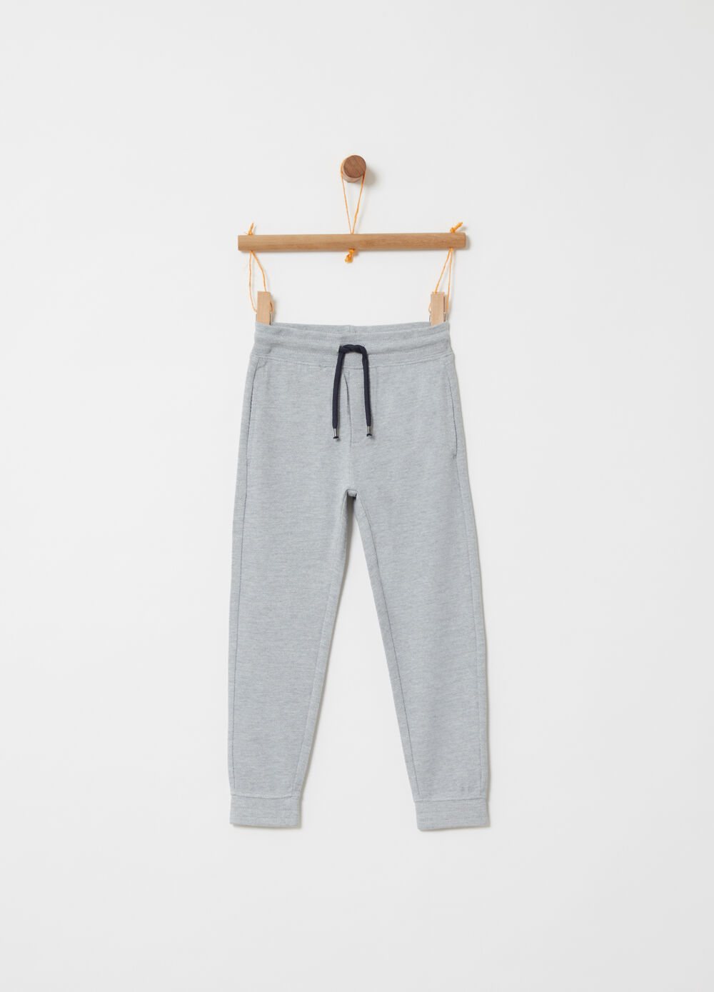 Piquet trousers with functional pockets