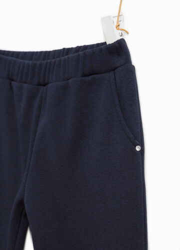 Trousers with faux fur turn ups