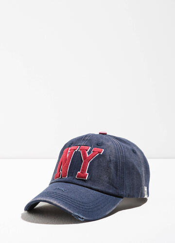 Worn-effect baseball cap with patches