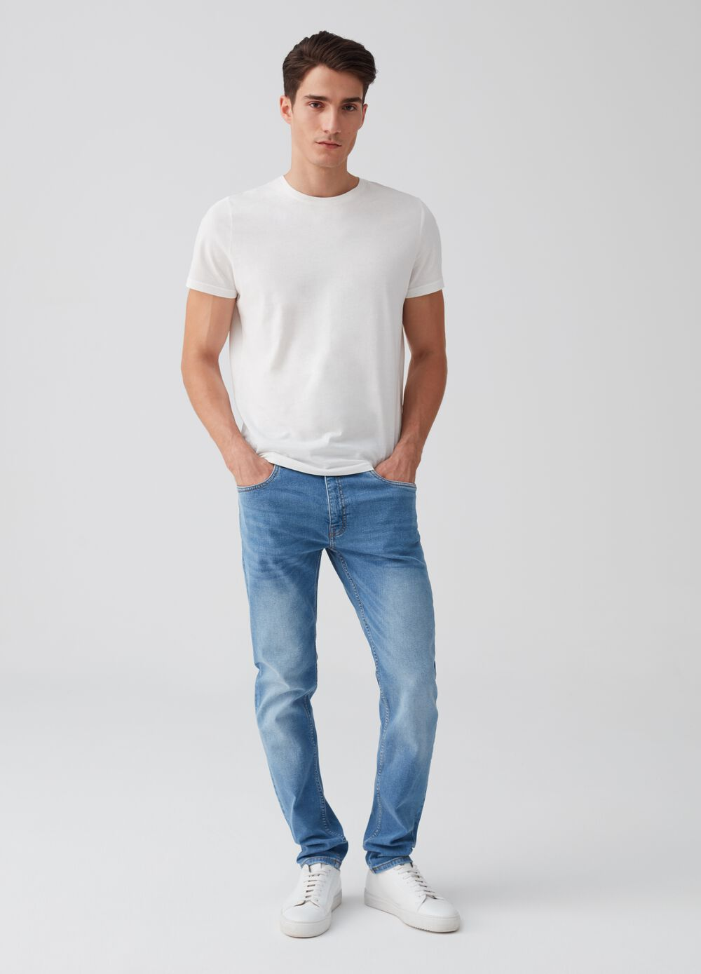 Slim-fit stretch jeans with slits and pockets