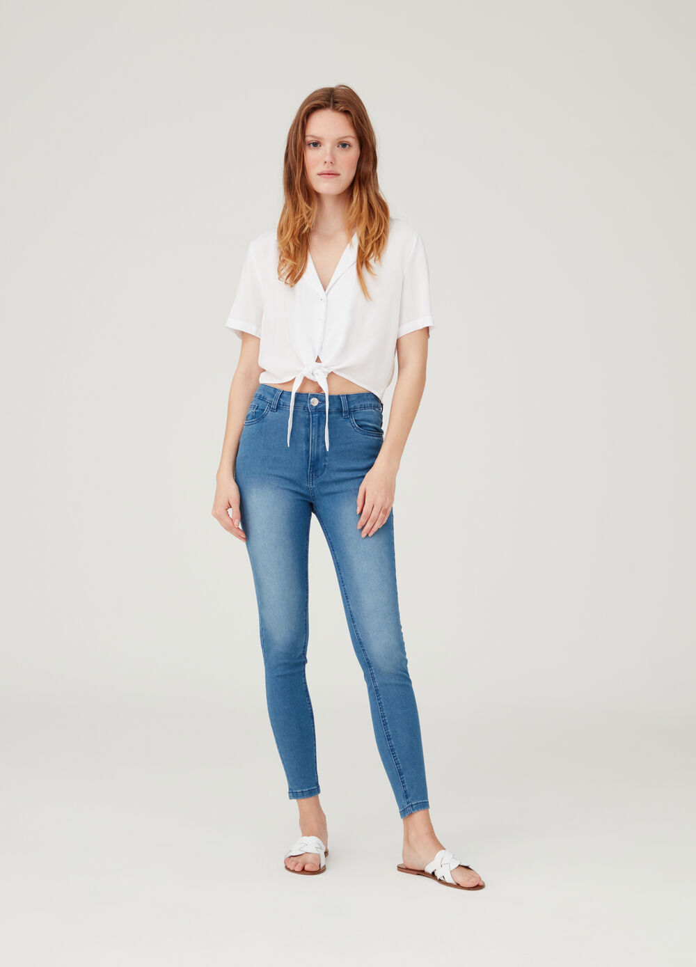 Worn-effect jeans with five pockets