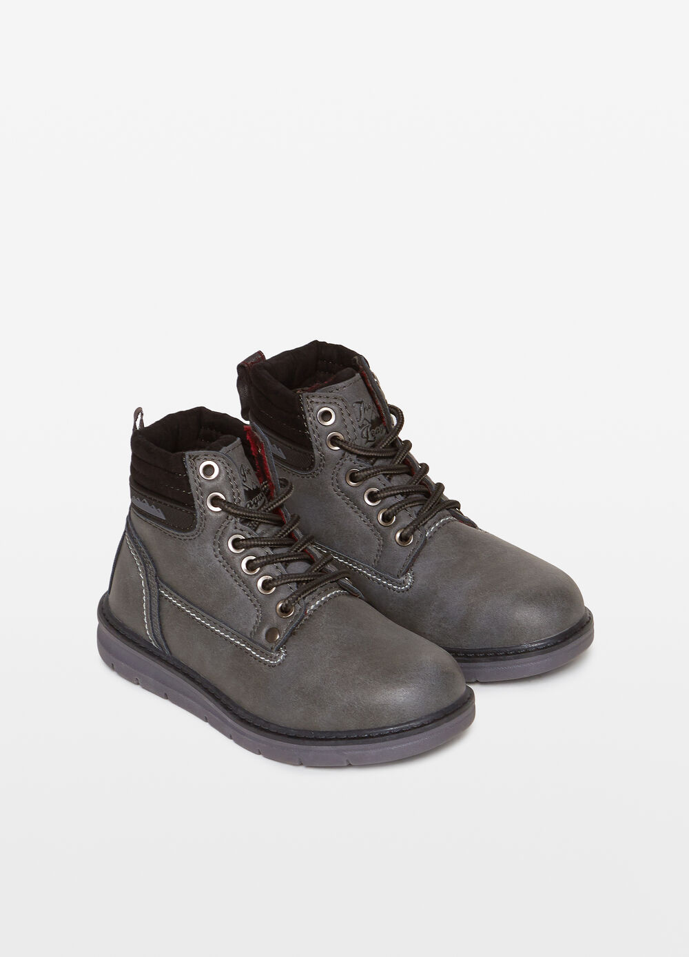 Ankle boots with laces and stitching