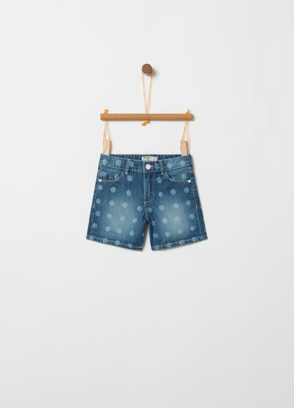 Denim shorts with polka dot pattern