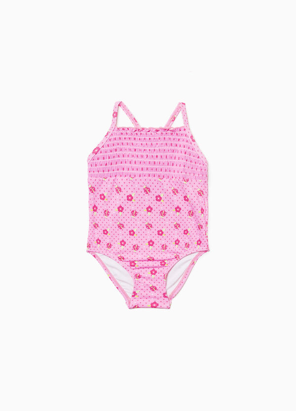 One-piece stretch swimsuit with pattern and gathering