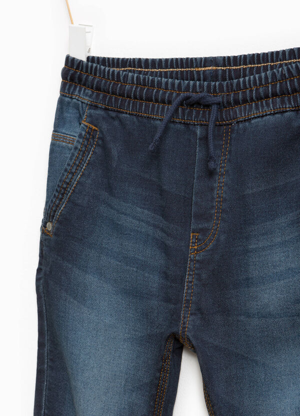 Washed-effect stretch jeans with drawstring | OVS