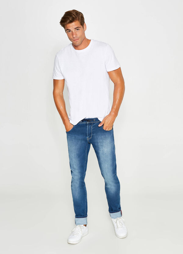 Worn-effect slim-fit stretch jeans with drawstring