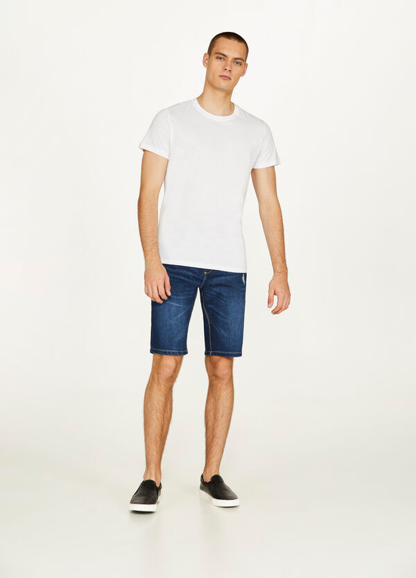 Slim-fit denim Bermuda shorts with abrasions
