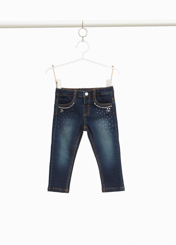 Faded-effect stretch jeans with diamantés