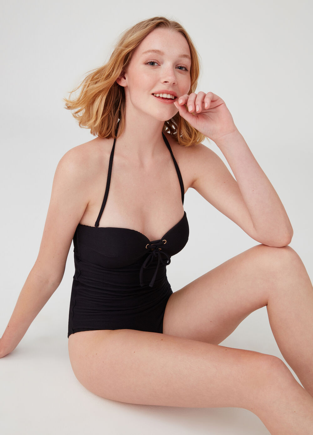 One-piece swimsuit with sweetheart neckline and ties