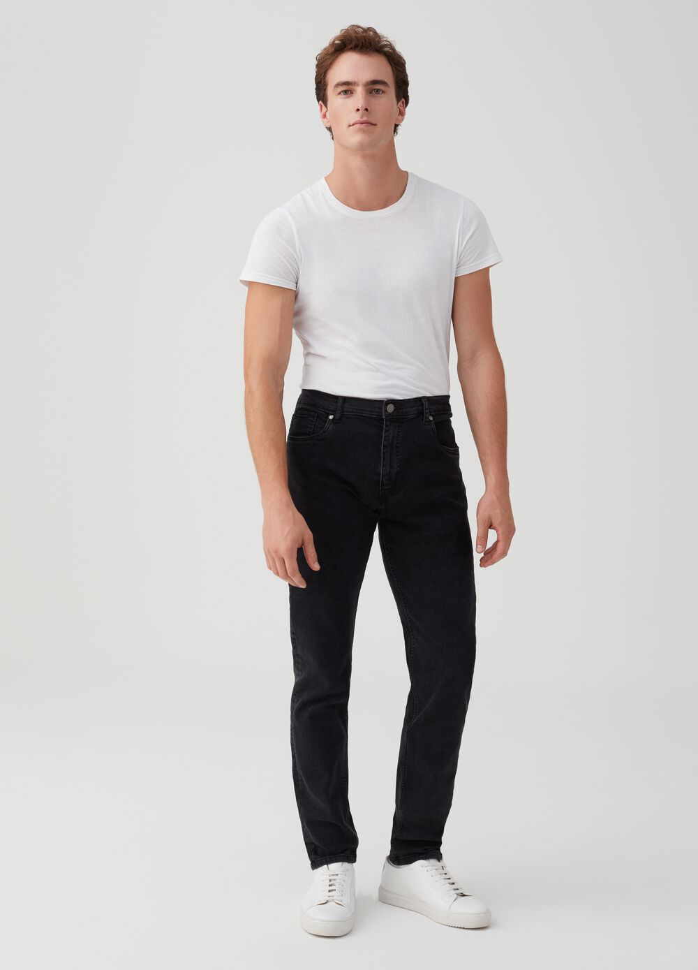 Five-pocket slim-fit jeans with button