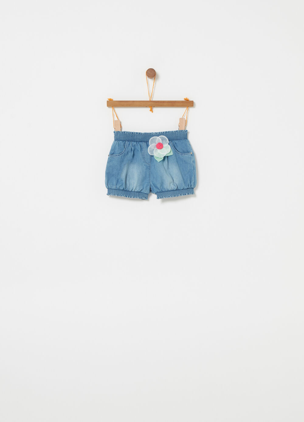 Denim shorts with diamantés, rivets and flower