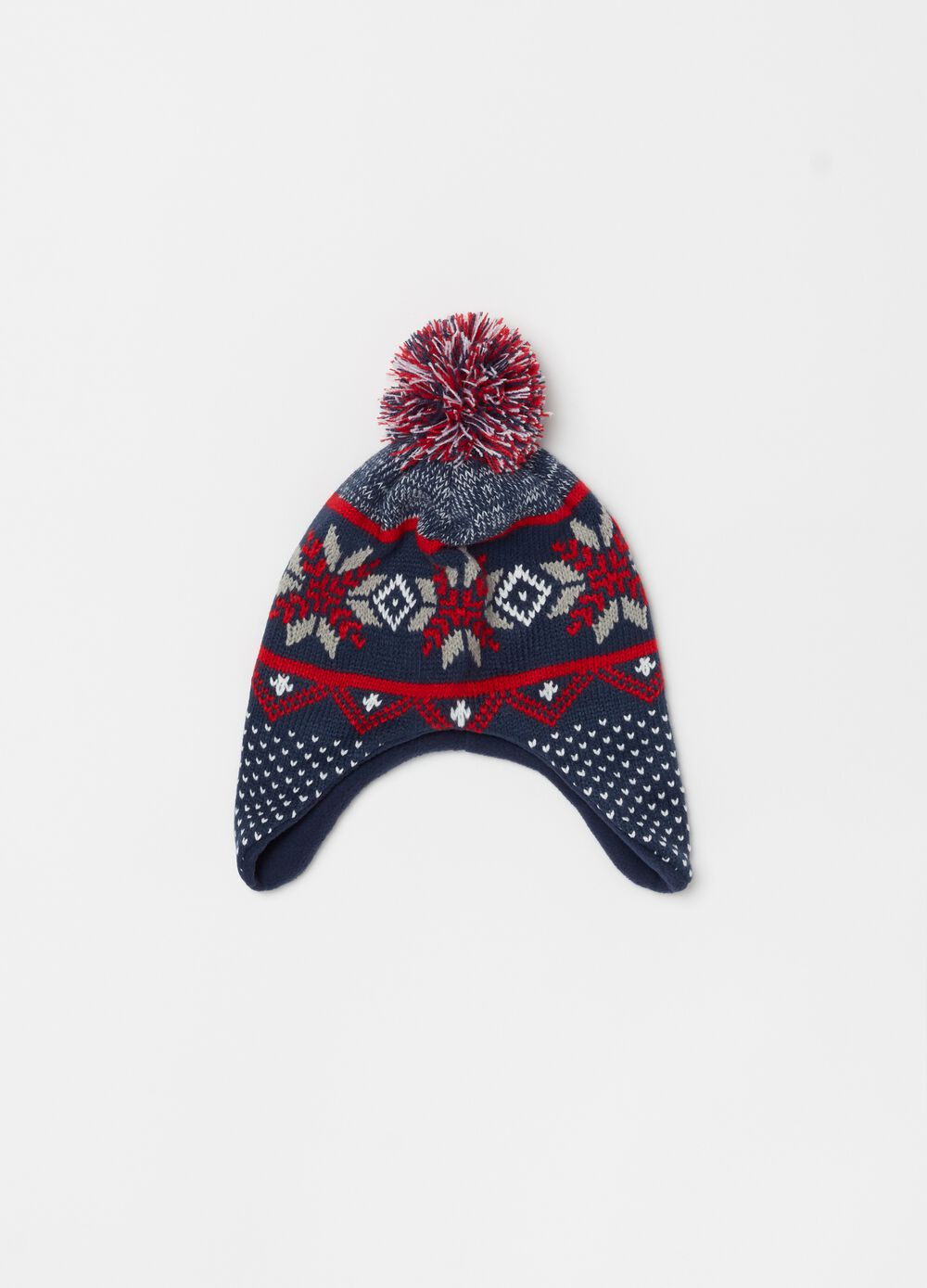 Knitted hat with patterned pompom