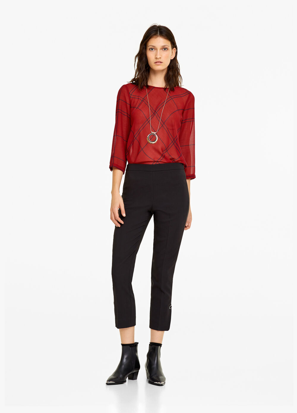 Stretch trousers with eyelets