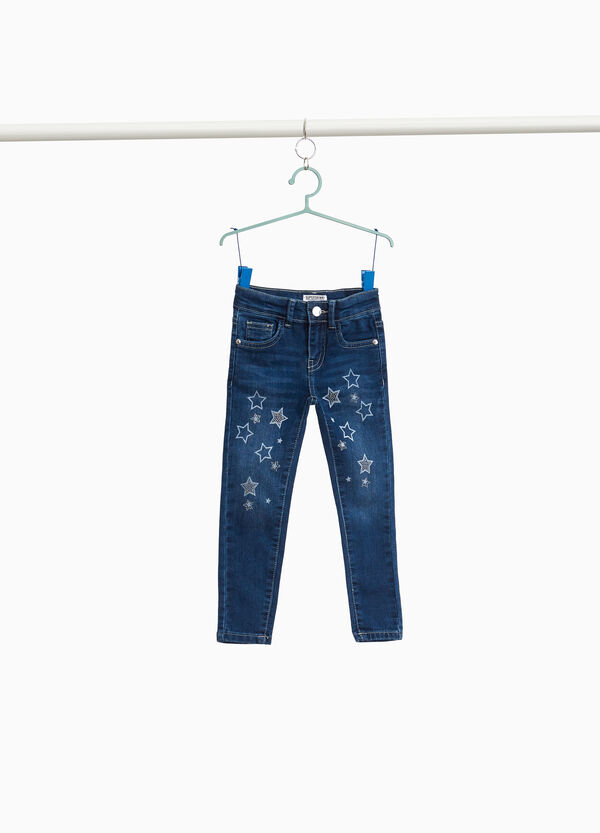 Jeans con stampa a stelle e strass