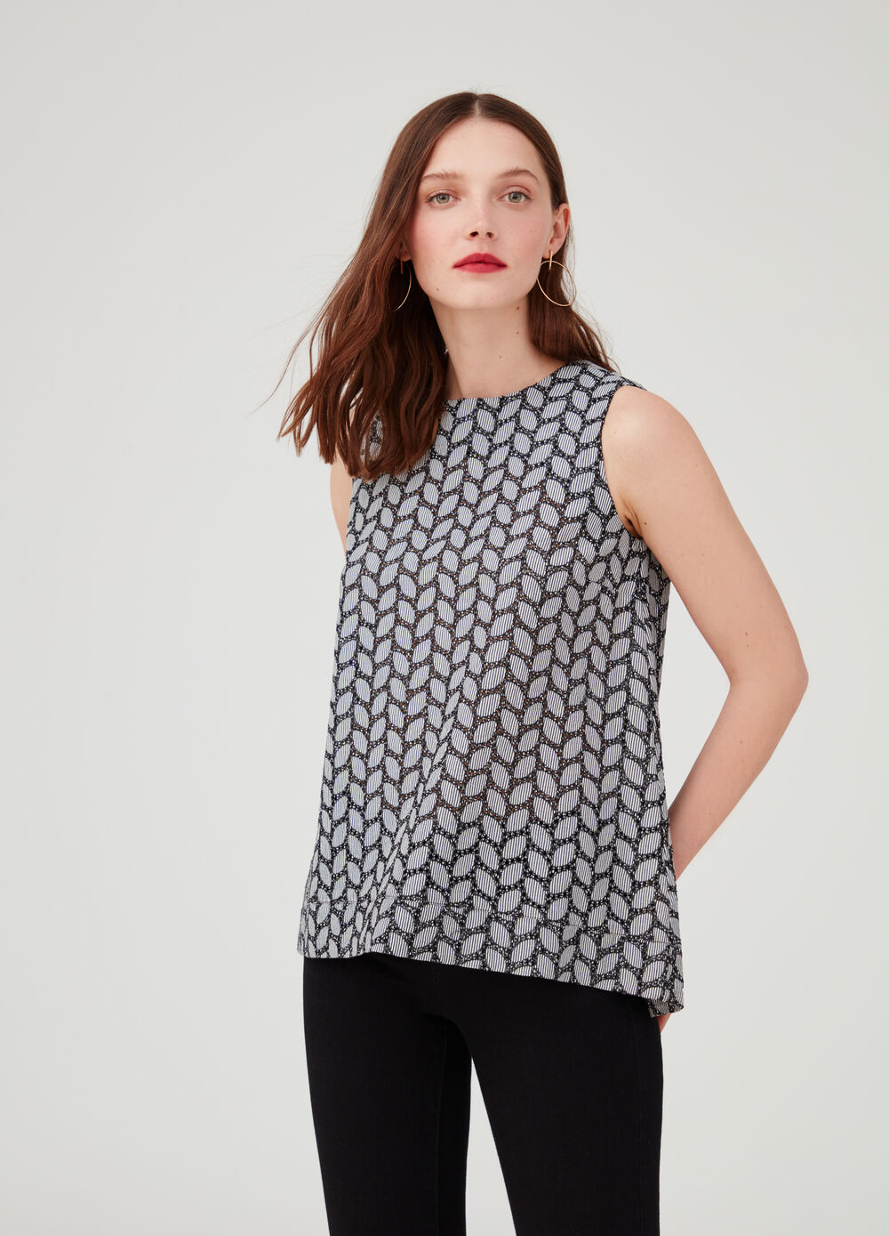 Sleeveless blouse with geometric pattern