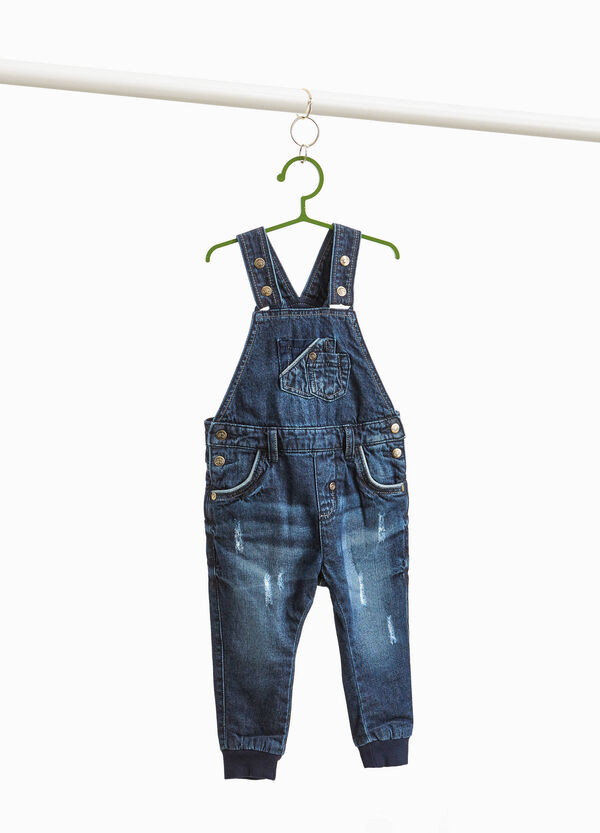 Worn-effect denim dungarees with abrasions