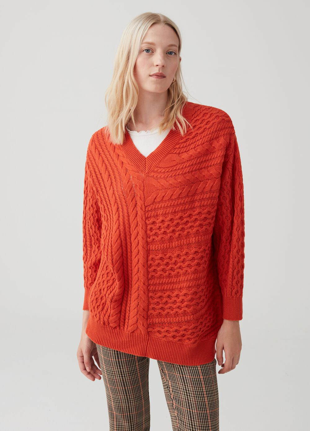 Knit pullover with geometric weave
