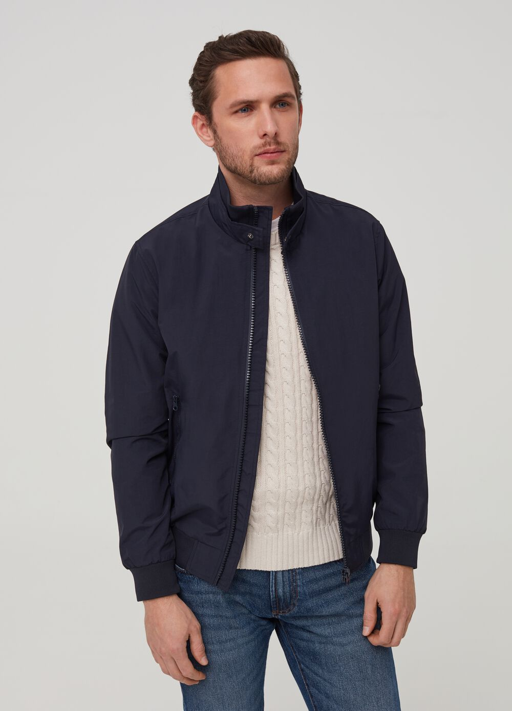 Solid colour jacket with high neck.