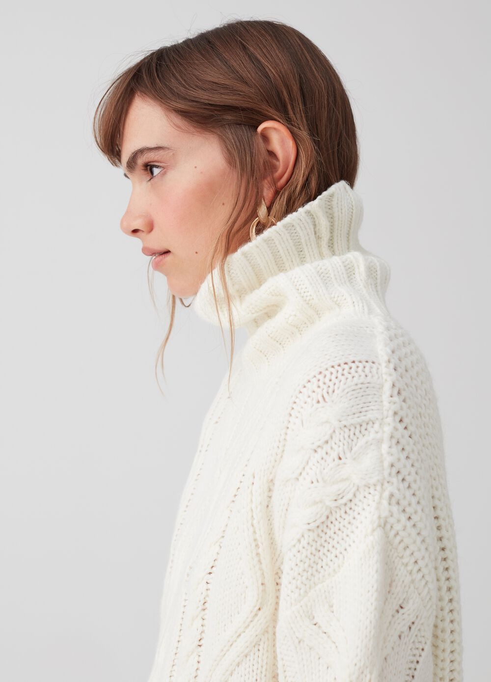Knitted pullover with high neck