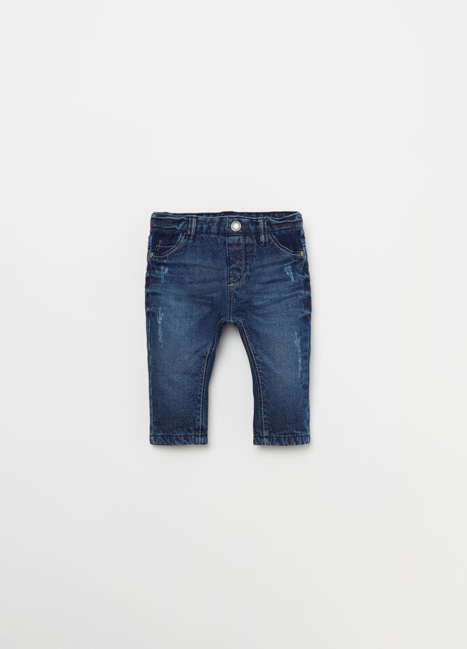 Worn jeans with fading and five pockets